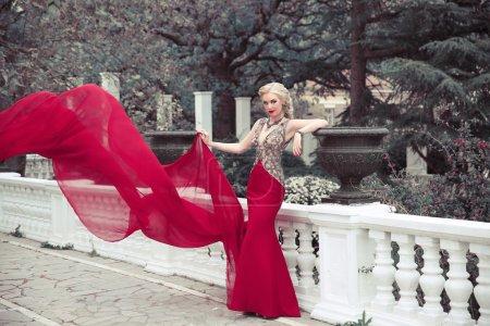 Beautiful elegant woman wearing in long mermaid fluttering fashi