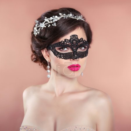 Elegant hairstyle. Beauty fashion Girl in black veil mask. Masqu