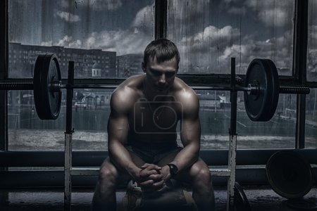 Athlete in old rusty gym