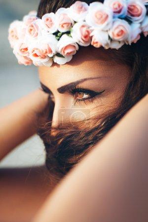 Sensual woman in floral wreath