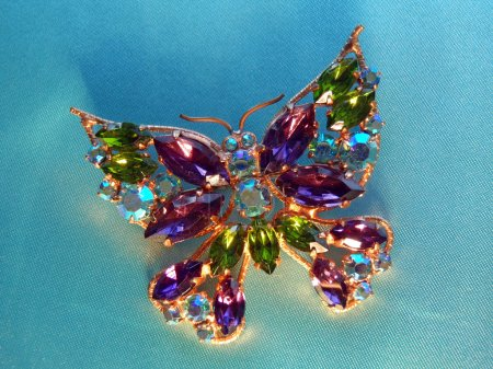 Beautiful butterfly brooch with multi-colored glass stones