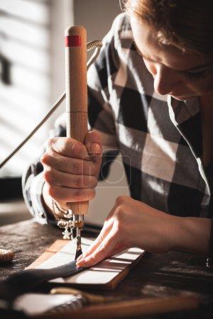 Leather handbag craftsman