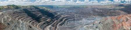 Panorama of quarry extracting iron ore with heavy ...
