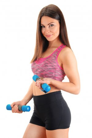 Young woman with dumbbells. Physical fitness