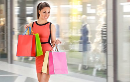 Young woman with bags in shopping mall