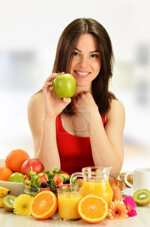 Photo for Young woman having breakfast. Balanced diet. - Royalty Free Image
