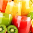 Composition with glasses of assorted fruit juices....