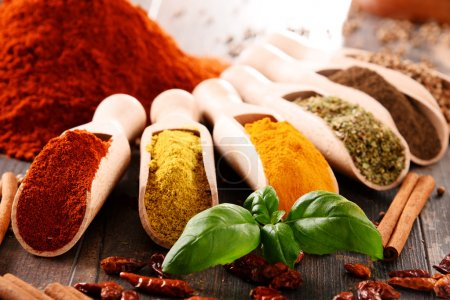 Photo for Variety of spices on kitchen table. - Royalty Free Image