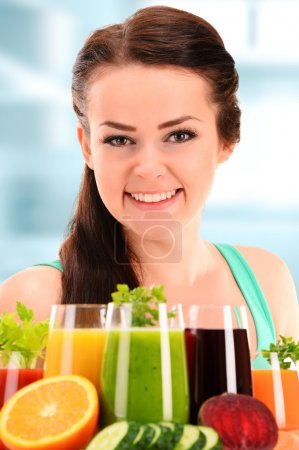 Photo for Young woman with variety of vegetable and fruit juices. Detox diet. - Royalty Free Image