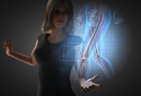 woman and hologram with knee radiography