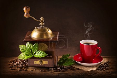 Coffee mill and a cup of coffee