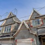 Scaffolds surrounding home following application o...