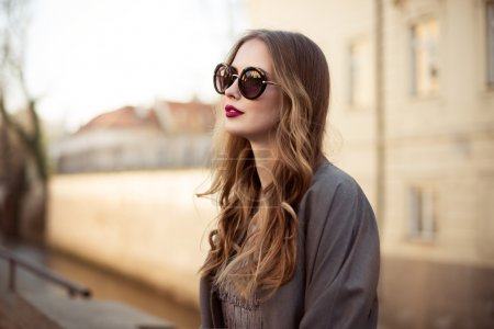 Beautiful young woman in sunglasses in the city