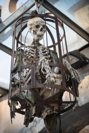 Human skeleton bones steel cage for torture