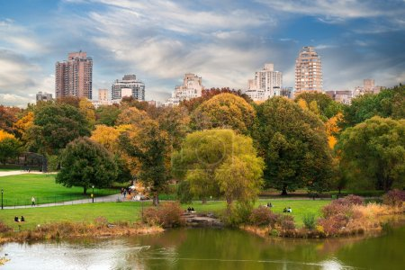 New York City Manhattan Central Park panorama with autumn lake with skyscrapers and colorful trees