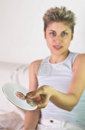 Woman holding compact disc