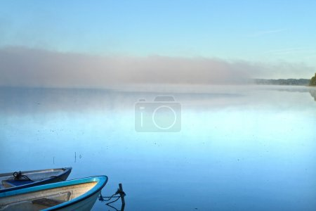 Lake with empty boats
