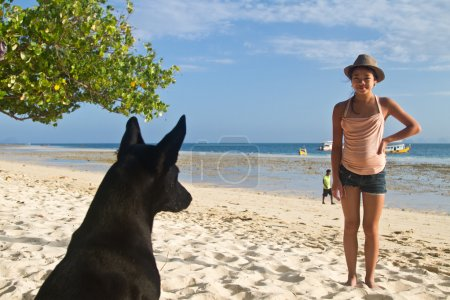 Dog and girl at the beach