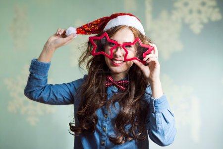 Happy smiling funny hipster girl in santa hat