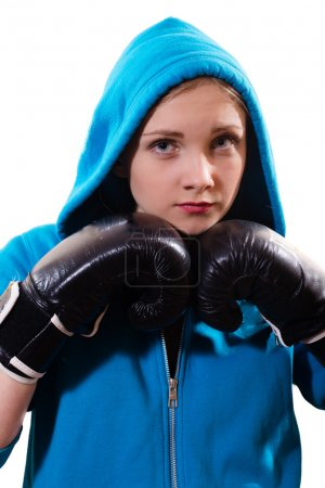 Young female boxer in gloves and hoodie