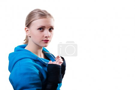 Young woman in boxing gloves