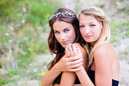 Two girls wearing wreaths
