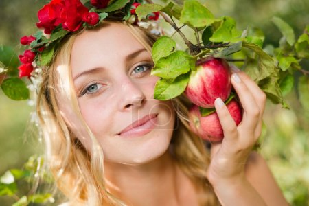Closeup on beautiful young lady apple fairy with three fruits