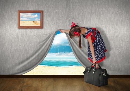 Photo for Child look at sea behind the wall, vacation concept - Royalty Free Image
