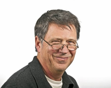 smiling man with reading glasses