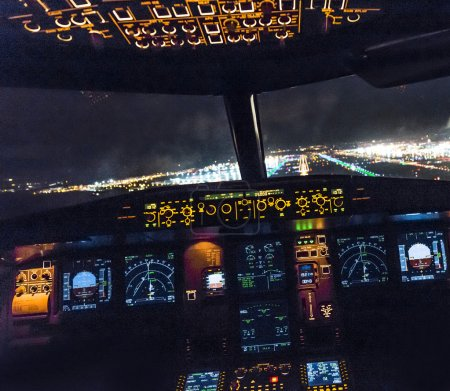 Cockpit view of a commercial jet aircraft  landing at the airpor