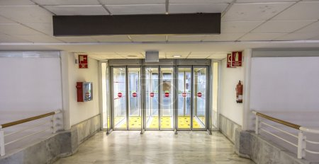 Empty isle and door in the arrival area at the airport in Arreci