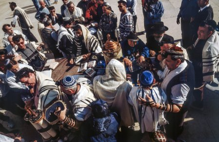 Orthodox jewish men pray at the Western Wall