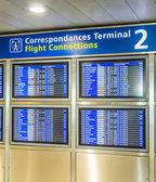 Board with the schedule of departures of planes indicates latest