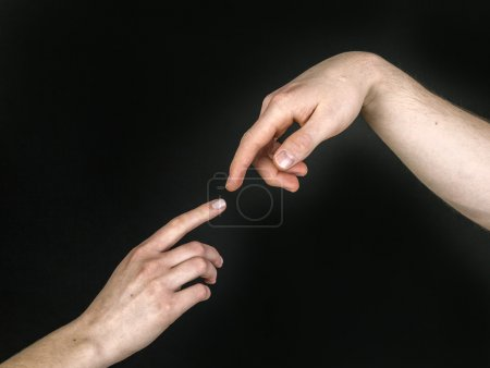 Fingers of Two People Nearly Touching