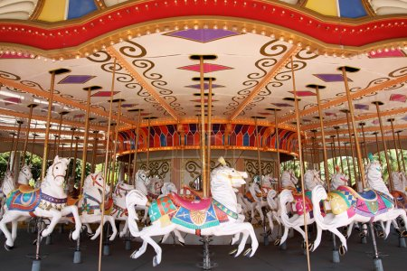 Photo for Empty carousel merry go round park attraction - Royalty Free Image