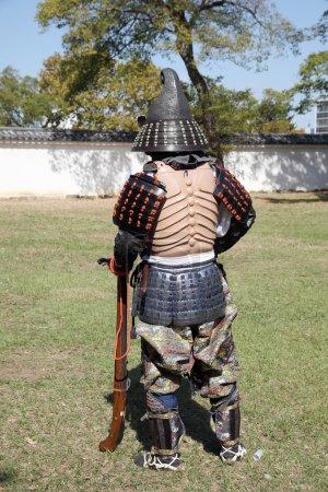 Japanese samurai with old rifle