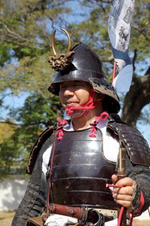 Poster: Japanese samurai with old rifle
