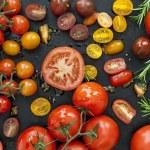 Tomato varieties on black iron.  Overhead view....