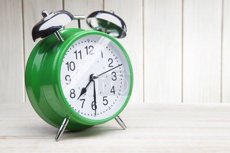Green alarm clock morning wake-up time
