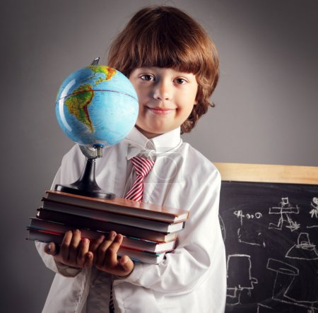 primary school student with books and globe