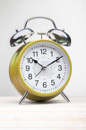 Orange alarm clock morning wake-up time