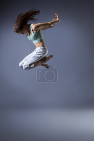 Photo for Beauty girl dance on grey background - Royalty Free Image