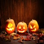 Jack o lanterns  Halloween pumpkin face on wooden ...