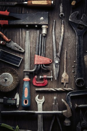 Photo for Grungy old tools on a wooden background (processing cross-process) - Royalty Free Image