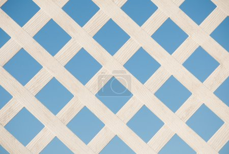 White lattice board against blue sky