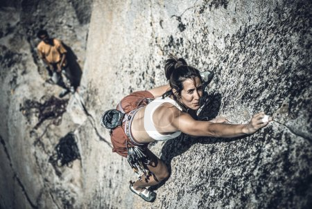 Female climber going for the summit.
