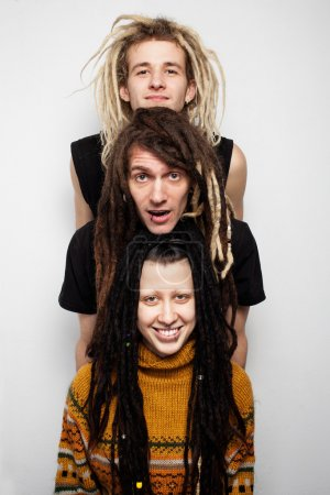 Photo for Close up group portrait of three positive dreadlocks, two boys and a girl, on white background - Royalty Free Image