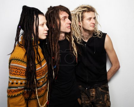 Photo for Group portrait of three positive dreadlocks , two boys and a girl, profile view, on white background - Royalty Free Image