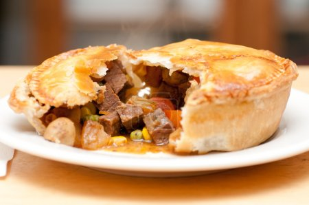 Photo for Meat pie made with roast beef in a savoury gravy - Royalty Free Image