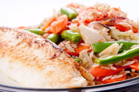 seared tilapia fish filet with rice stir fry